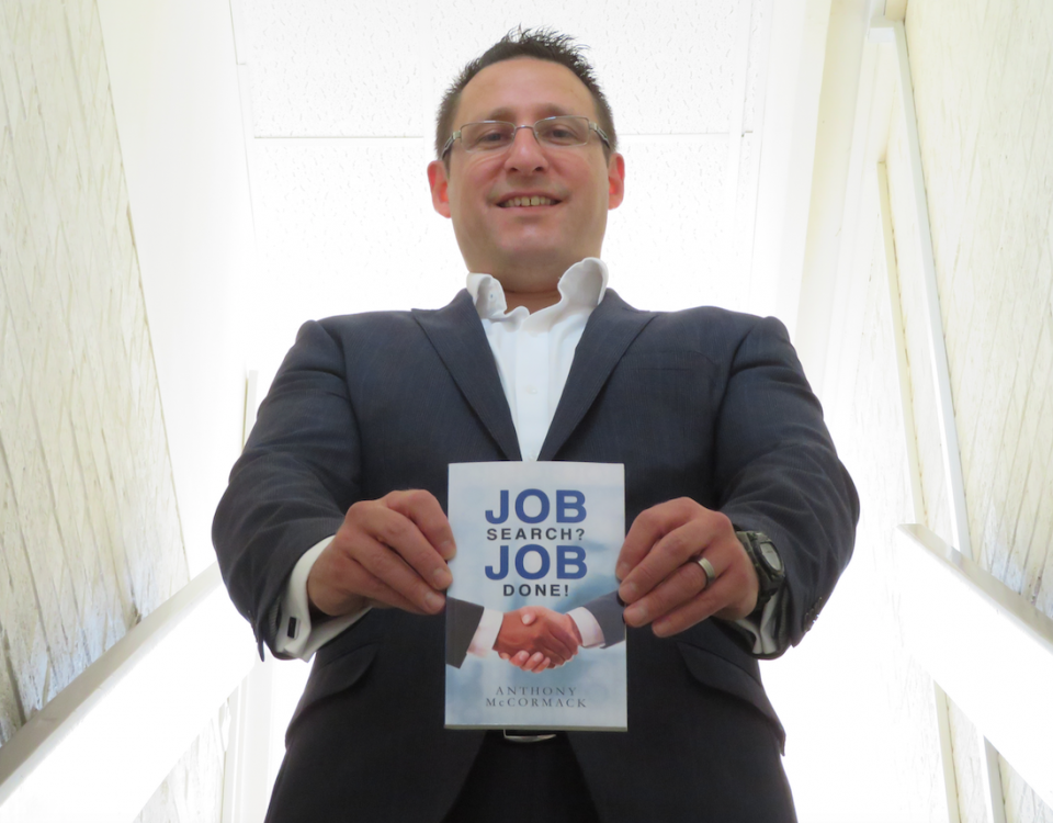 Anthony McCormack stands proud with a copy of the book 'Job Search? Job Done!' in his hands