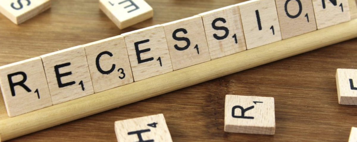 Scrabble pieces spell out the word recession