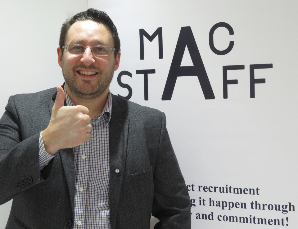 MD Anthony McCormack smiling with his thumb up