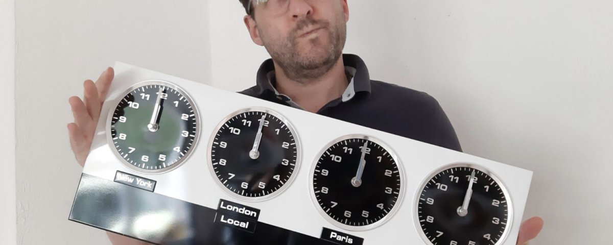 Macstaff MD Anthony McCormack with four clocks showing time zones from all over the world