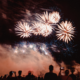 People watch fireworks explode on New Year's Eve